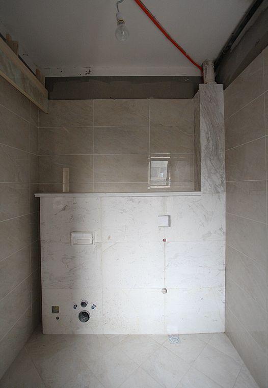 墙排马桶和感应便池 贴完砖的整体效果